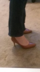 Brown pumps under jeans